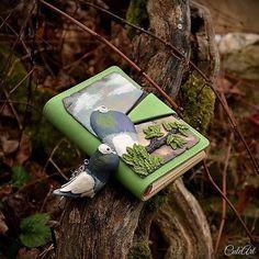 Organiser and a keychain for a pigeon breeder.. #pigeons  #organiser  #journal  #diary  #polymerclay  #pigeonbreeder  #keyring  #keychain #polymerclay  #madefromphoto  #handmade  #greatgift  #men  #women  #dnestvorim #vyrobenosrdcem  #organizer  #zapisnik  #filofax #klucenka  #privesok #chovatel  #holub  #swarovski