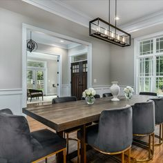 Perfect for entertaining, this open concept dining room has detailed trim work, 10' and double height ceilings, recessed lights, wide plank hardwood flooring, and a modern light fixture. Listed in Vienna, VA for $1,599,999 by The Casey Samson Team, a Wall Street Journal Top Team in Northern Virginia.