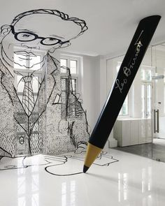 A3m-high line drawing of agency founder Leo Burnett set across the wall, ceiling and floor is the centre piece of the office's reception, along with a floor-to-ceiling height trademark Leo Burnett pencil, set as though it has stopped mid-line
