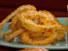 Oven Fried Onion Rings from FoodNetwork.com.. so trying these today. 10/14/2012.. i actually made these and they were yummy.. Do NOT forget the oil in the crumbs, they are a really important part of making them crunchy.