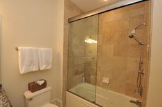 Tile tub/shower with seamless enclosure