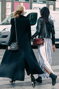 long floor length black coat + black and white crossbody bag + black heels + leather jacket + striped navy and white maxi skirt dress + maroon crossbody bag + ankle boots