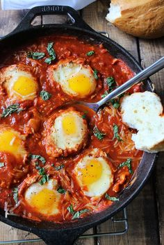 Eggs in Hell are a quick and spicy way to enjoy your eggs in the morning. With plenty of spices, Parmesan cheese and eggs poached in tomato sauce.