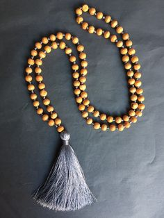 Available online: Our handmade BALI SILK TASSEL NECKLACE (Colour: Grey)