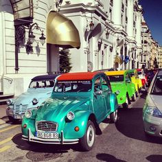 A very #colourful #2CV #parade. Looks like it's carnival.