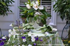 Moonlight and Magnolias, Romantic Table Setting for Two  --  I could do this now, my Magnolia trees are in bloom.