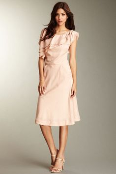 kendal k dress. I love the asymmetrical ruffle at the top. I wonder that I could upcycle an old dress like this.