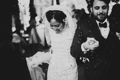 "The rice was flying as we danced down the aisle to ""I Feel Good"" by James Brown. I had rice in my hair for days. #weddingstories #blackandwhite #brooklynwedding #newyorkwedding"