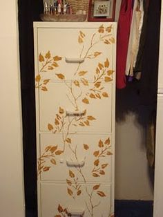 A non-ugly metal file cabinet - decorated with wall paper and mod podge.