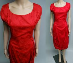 Gorgeous 1950s Red Brocade Dress What a gorgeous cocktail dress Wow ~ Wow ~ Wow Rounded Neckline Low Back Red Brocade fabric So sexy and just plain unforgettable Such Class and Style is in this 1950s party dress Notice the bottom how it is pleated and a fabric rose on the bottom of hem in the front Just a glamorous look Nipped Waistline to show off those curves Surely you will get a few whistles along the way It is in excellent condition Has a back metal closure Measurements are as follows…