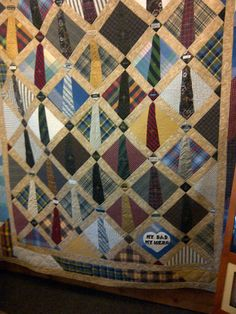 A quilt made for my cousin made from shirts/ties of my uncle's who died before getting to see his only child graduate from high school.