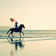 horseback riding on the beach - we should add this to the bucket list