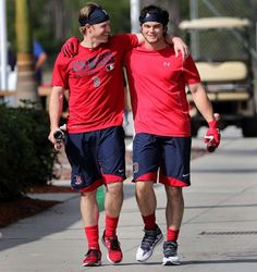 2017 spring training:    Brothers‐in‐arms:   Boston Red Sox outfielders Brock Holt, left, and Andrew Benintendi play to the cameras as they head back to the clubhouse after taking indoor batting practice during spring training at Jet Blue Park in Fort Myers, Fla., on Feb. 16.