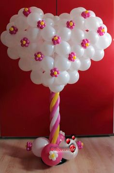 Heart balloon sculpture wit adorable blossom accents