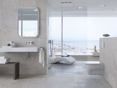 Sometimes we need to look beyond the indoors for interior design inspiration. The fantastic coastal views in this master bathroom complete the resort-spa look and feel of the space.
