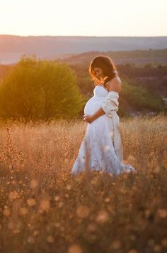 who doesn't love the idea of a white dress in a field of wild flowers?