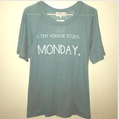 WILDFOX TINY HORROR STORY TEE WILDFOX TINY HORROR STORY T-SHIRT. Teal Colored. $68.00 M.S.R.P sold out. Last pic shows exact color. Has about 4 snags right under Monday. Looks like it was worn-washed & returned to store(some pilling on back bottom left side) ❤️ this shirt & I purchased regardless of defects but I still haven't worn yet. Selling as is. FIRM PRICE$ Wildfox Tops Tees - Short Sleeve