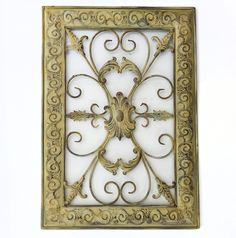 """French Scroll Frame 38.00  Our French Scroll Frame is made from metal and is shades of gold, brown and a dark grey.  Embossed and raised in the detail areas of the frame the inside is cut out to show the wall behind it.  Very lightweight and eye catching.  Can be hung vertically or horizontally.  It measures:  24"""" L x 17"""" W x 1"""" D or if turned 17"""" W x 24"""" L x 1"""" D"""