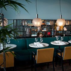 Here at Caffè Burlot, the eye is immediately taken by the choice of bold upholstery and wallpapers – tropical greenery and oriental gold fans – and although the main theme is Italian, there is influence form the Near and Far East in evidence not only on the walls but in rugs and ceramics as well...