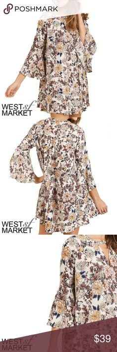 -NEW ARRIVAL- The Charlotte Keyhole Dress Flowy dress with three-quarter length slightly flared sleeves! Cream with a gorgeous floral print. Keyhole at the neck makes it sweet but sassy! West Market SF Dresses Mini