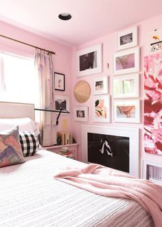 A dramatic top to bottom gallery wall in the bedroom. Interior design ideas for the bedroom.