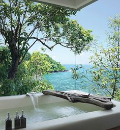 This is a bathtub at a resort in Cambodia, but I would love this type of configuration if I ever own a house on the beach.