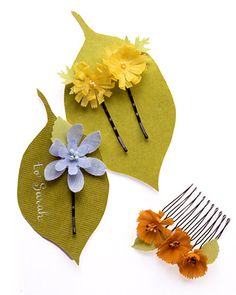 Punched Floral Barrettes  Constructed out of fabric-punched blooms, flowering hair clips are a chic accessory during any season.  How to Make Punched Floral Barrettes