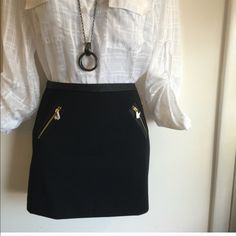 Brand new Express mini skirt with leather & gold Accent. Firm unless bundled. Thank you. Express Skirts Mini