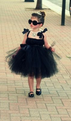 Breakfast at Tiffany's! Such a cute and easy costume to make! All you need is black ribbon, black fabric, and black tulle. Finish with a pearl necklace and mini tiara.