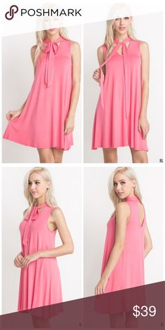 """Gorgeous front tie swing dress! This sleeveless tie neck dress features a V-shaped back cutout.  SIZE + FIT Model is 5'8"""" and wearing size Small.  Measurements taken from size Small: - Length: 33.5"""" - Chest: 34"""" Dresses"""