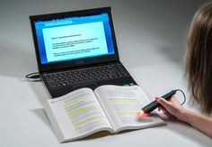 A pen shaped scanner that will scan any printed text and automatically insert it into any application on your computer.