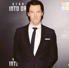Benedict Cumberbatch biting his bottom lip. you are welcome.