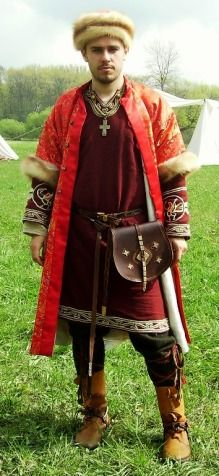 Great Moravian Nobleman dressed in brocade kaftan, silk and woolen tunic. Accessories like belts, clasps, cross, pouche are based on findingd. Ca 9th century. Author Kain