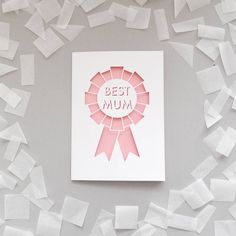 A greetings card featuring papercut text reading 'You're the Best Mum'.A die cut papercut mother's day card with a cut out geometric rosette design featuring text reading 'Best Mum'. Perfect to tell your mum how much she means to you! The card features a white outer layer which is cut to reveal a pale pink insert, and is supplied with a white gummed envelope.160gsm white paper and 280gsm pale pink card.H10.5 x W15 cm