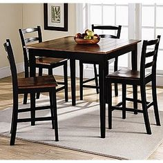 ave some friends over for a good time. This handsome casual counter-height dining set includes a table and four ladder-back chairs and will have everybody wanting to come hang at your house. Great for get-togethers or for having some family fun. Features a two-tone finish and golden oak tops with dark walnut bases. Attractive plank detailing on golden oak tabletop. Transitional styling that will accentuate any decor. Assembly required.