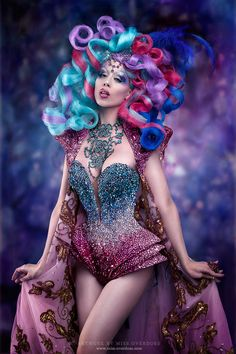 I love the hair! Turquoise, purple, fuchsia blue, awesome outfit! probably great makeup
