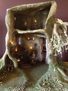 some pinner: My current miniature doll house project: fairy tree trunk house with bonsai weeping cherry, pond, lighting and fairy dust. Thx for looking :)