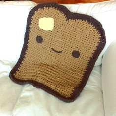 Diy Crafts - This toasty blanket with a patch is the most darling thing I've seen in a very long time! Toasty Blanket by Trish Young is a fun crochet Crochet Food, Cute Crochet, Crochet For Kids, Crochet Crafts, Crochet Cupcake, Crochet Birds, Crochet Humor, Quick Crochet, Diy Crafts