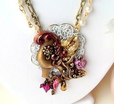 Cinderella's Slipper Pendant features a Victorian shoe stamping from B'Sue Boutiques. Lovely feminine colors.