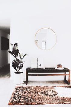 entryway // black bench // round mirror