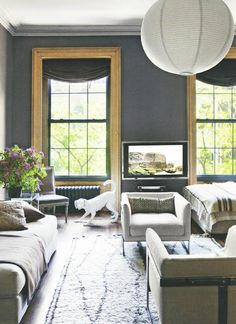 Micaela House - gray walls with natural wood trim and painted ceiling moulding. very nice twist