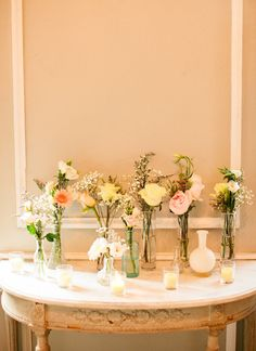 Simple flowers in glass bottles w/ candles // Photography By / http://lindsaymaddenphotography.com,Floral Design By / http://lovephilanthropy.com