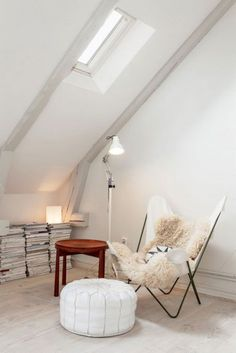 For a cosy reading nook, incorporate natural lighting with accents of timber, leather and sheepskin #FieldNotes #interiordesign #styling #trends #butterflychair