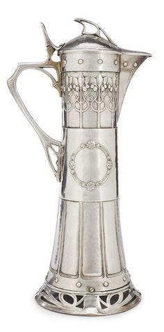 A tall Württembergische Metallwarenfabrik silver plated copper decanter circa 1900