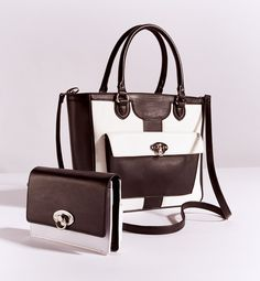 Accessories that work.  Colorblocking creates the ultimate polish in signature black and white.