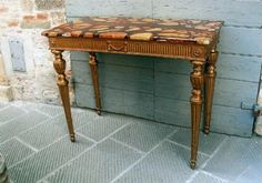 coppia di consolles in legno dorato Antiquariato su Exclusive Antiques