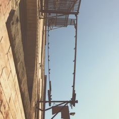Get a new #perspective today! Maybe some #re-framing is in order-take this rung-less ladder for example. It's no longer climbable, but it's a great way to frame the #minneapolis #sky. #dogood #giveback #earn #gobuylocal #locallove #mn #wi