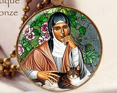 Cats in Art and Illustration: Saint Gertrude of Nivelles (also spelled Geretrude, Geretrudis, Gertrud) (ca. 621 – March 17, 659) was a seventh-century abbess who, with her mother Itta, founded the monastery of Nivelles in present-day Belgium. While never formally canonized, Pope Clement XII declared her universal feast day to be March 17, the same as Saint Patrick, in 1677. She is the patron saint of travelers, gardeners, cats, cat fanciers and against rats and mental illness. Art Decor, Illustration, Cat Art, Angels And Demons, Art, Rainbow Bridge, Prints
