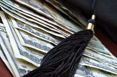 Higher education conceptual image with graduation cap and tassel on american currency. Macro with extremely shallow dof.; Shutterstock ID 44454148; PO: OPED