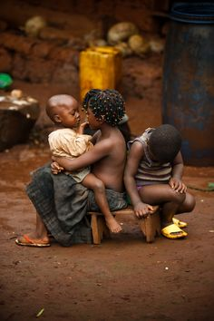 Children keep each other company outside their home in Cameroon Africa, 2011